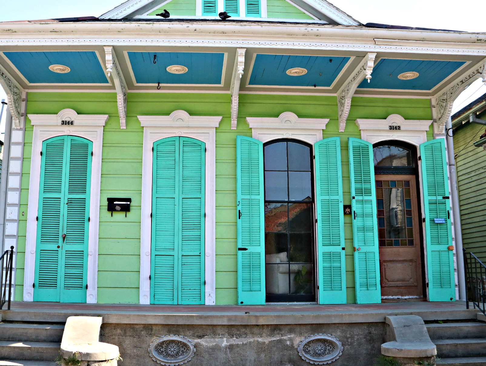 homes more windows doors and shutters on the street you see more and more attractive colors and more time spent by owners to show off their homes and